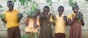Children in Uganda with trees to be planted